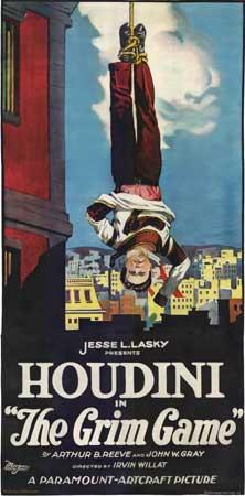 En affisch från Houdinis A Grim Game där han hänger upp och ner